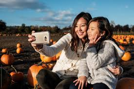 Asian Mother and Daughter Taking Selfie Picture During Pumpkin ...